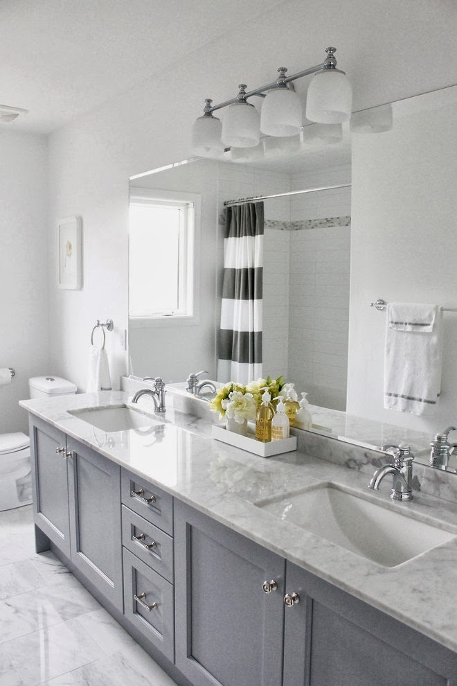 Decorating cents gray bathroom cabinets for Grey and white bathroom decor