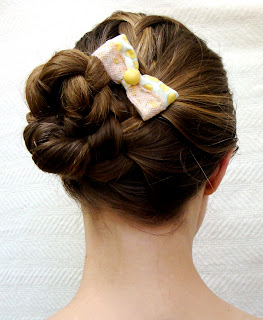 braided updo hair style with repurposed fabric bow in small