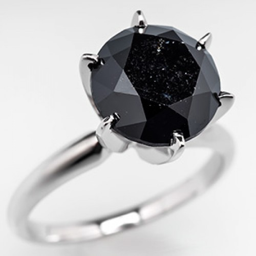 This showstopping black diamond engagement ring features a 5-carat,  irradiated diamond set in a solid 14k white gold mount. Black diamonds are  becoming ...
