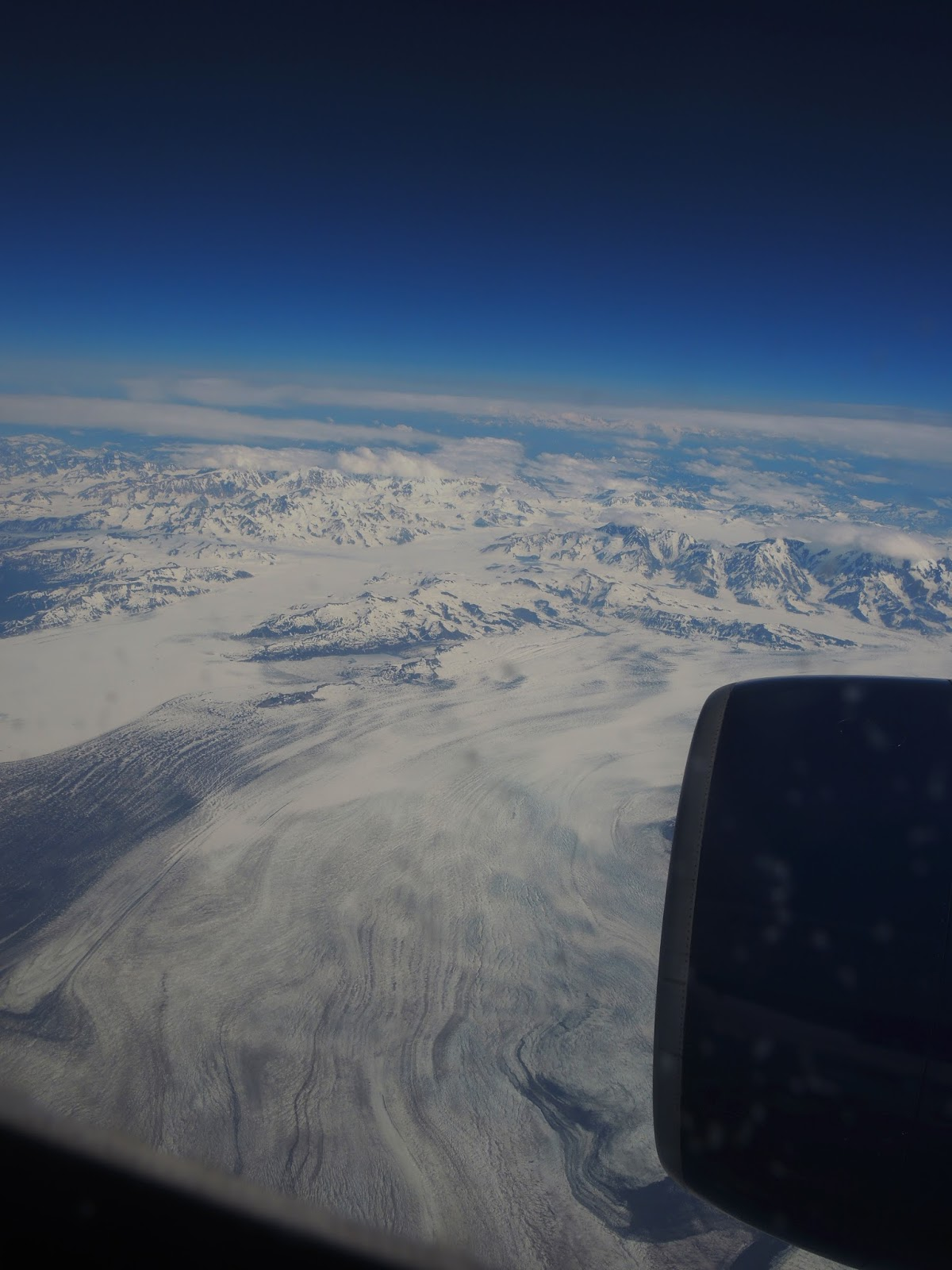 we landed in anchorage just before noon akdt we were really there the airport is pleasant and easy to navigate so we quickly got our luggage and went to