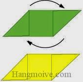 Bước 3: Xoay tờ giấy xanh cho vuông góc với tờ giấy vàng.