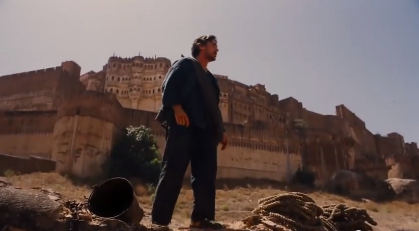 Bruce Wayne climbs out of The Pit and runs to Mehrangarh Fort