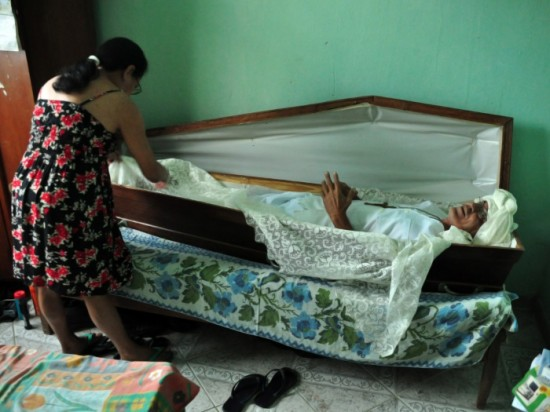 Man Sleeps in Coffin Case
