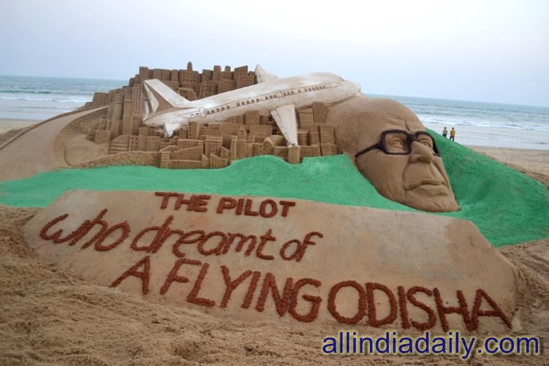 "On the occasion of 97th birth anniversary of Sri Biju patnaik Sudarsan Pattnaik have created a sand sculpture with a message ""The Pilot who dreamt of a Flying Odisha"" at Puri beach of Odisha"