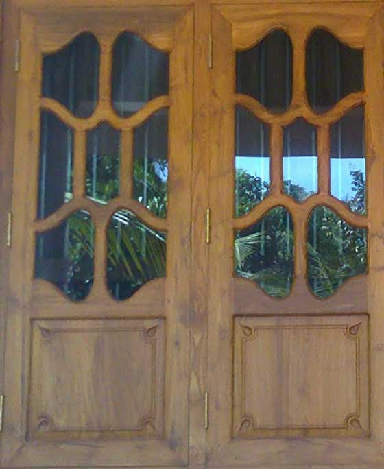 Latest kerala model wooden window door designs wood for Wood windows colorado