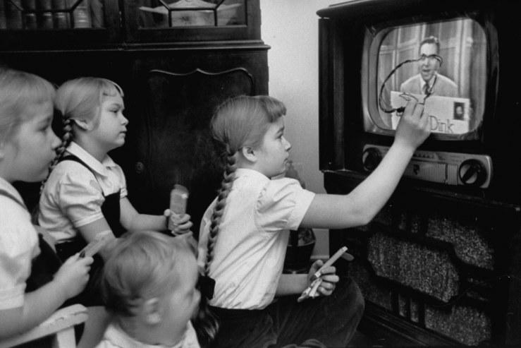 black kids watching tv. six-year-old girls use a \ black kids watching tv