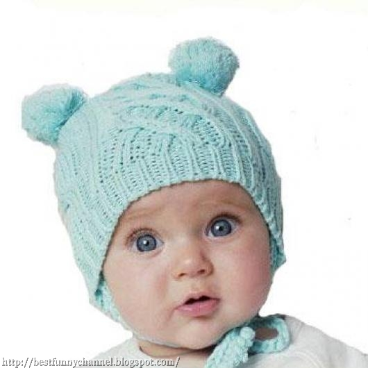 Funny baby in a cap with ears.