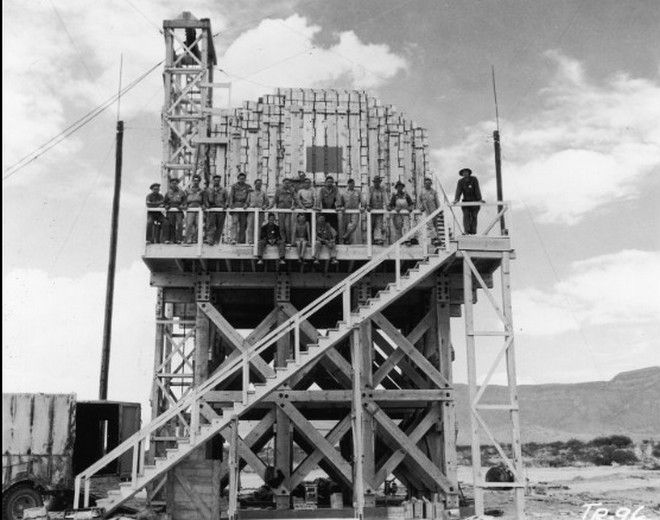 20 Shocking Pictures Of Hiroshima, The First City In History To Be Destroyed By An Atomic Bomb - Workers at Los Alamos posing with 100 tons of TNT.