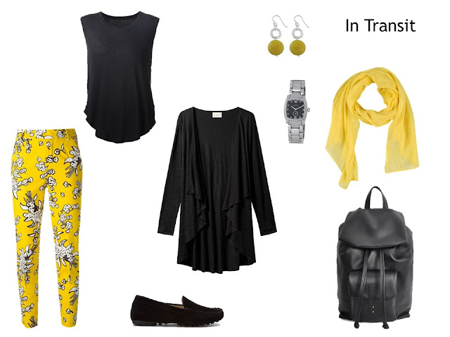 travel outfit black cardigan and top, with yellow floral pants and yellow accessories