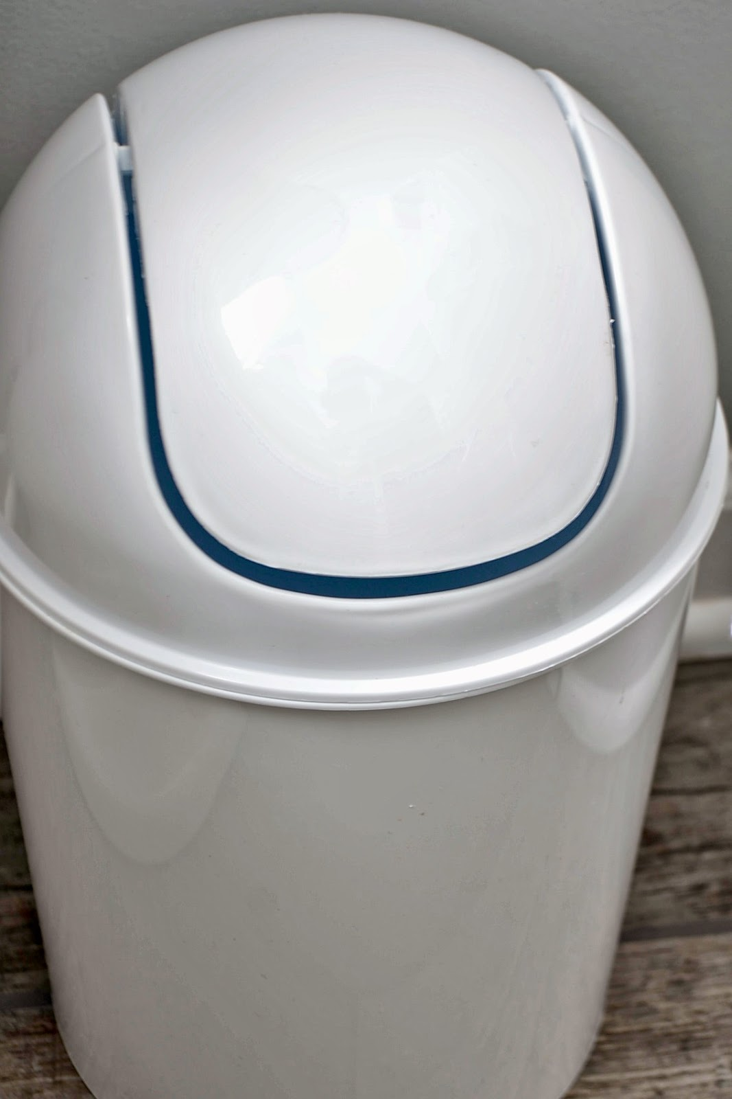 use a covered garbage can in your bathroom