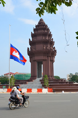 Death of King Norodom Sihanouk, flag at half-staff at Independence Monument, Phnom Penh, Cambodia
