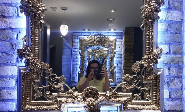 Toilets in Cardiff Slug and Lettuce blue lighting with silver floral mirrors