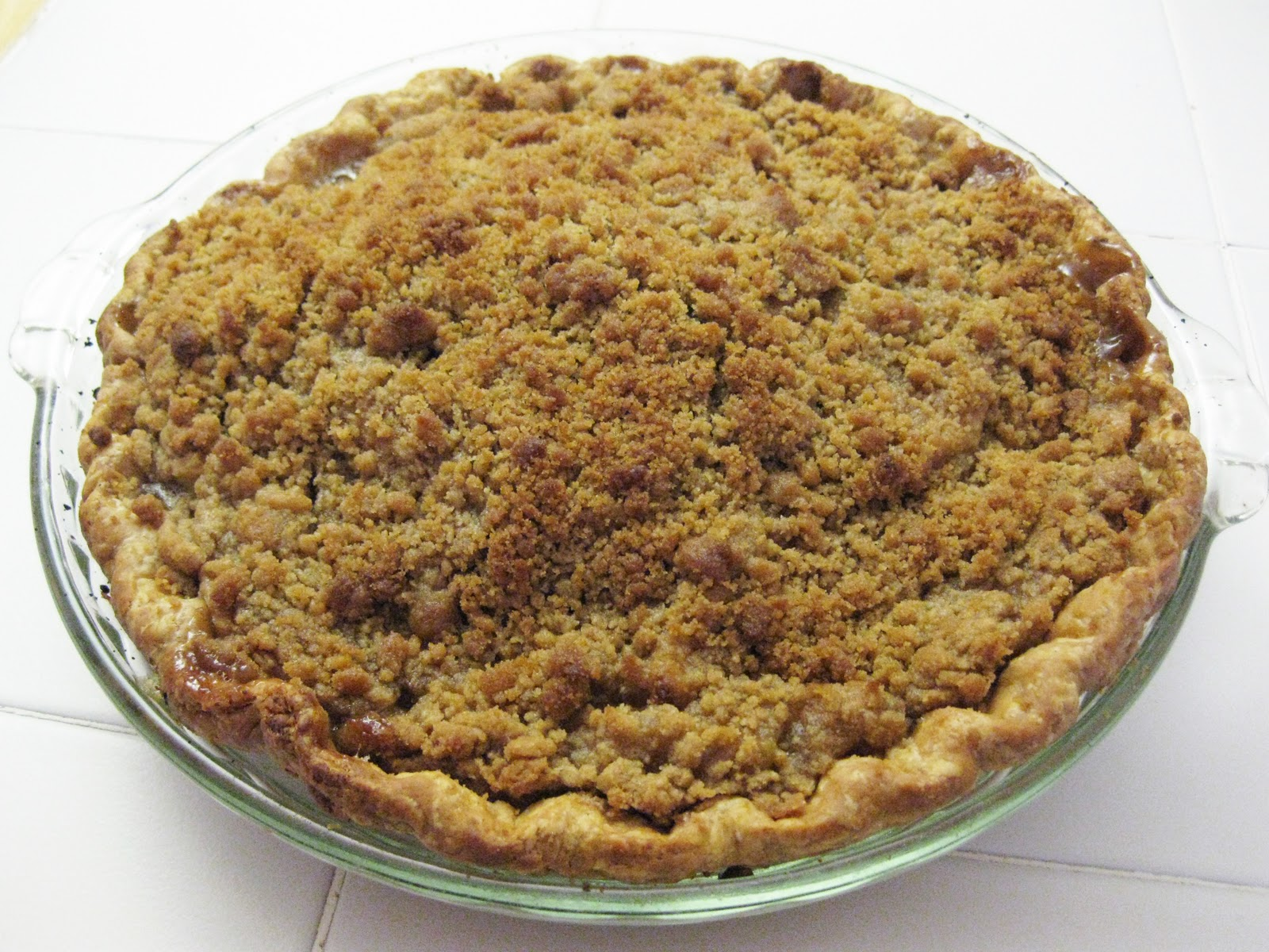 mixed streusel topping apple filling in pie shell sprinkling streusel ...