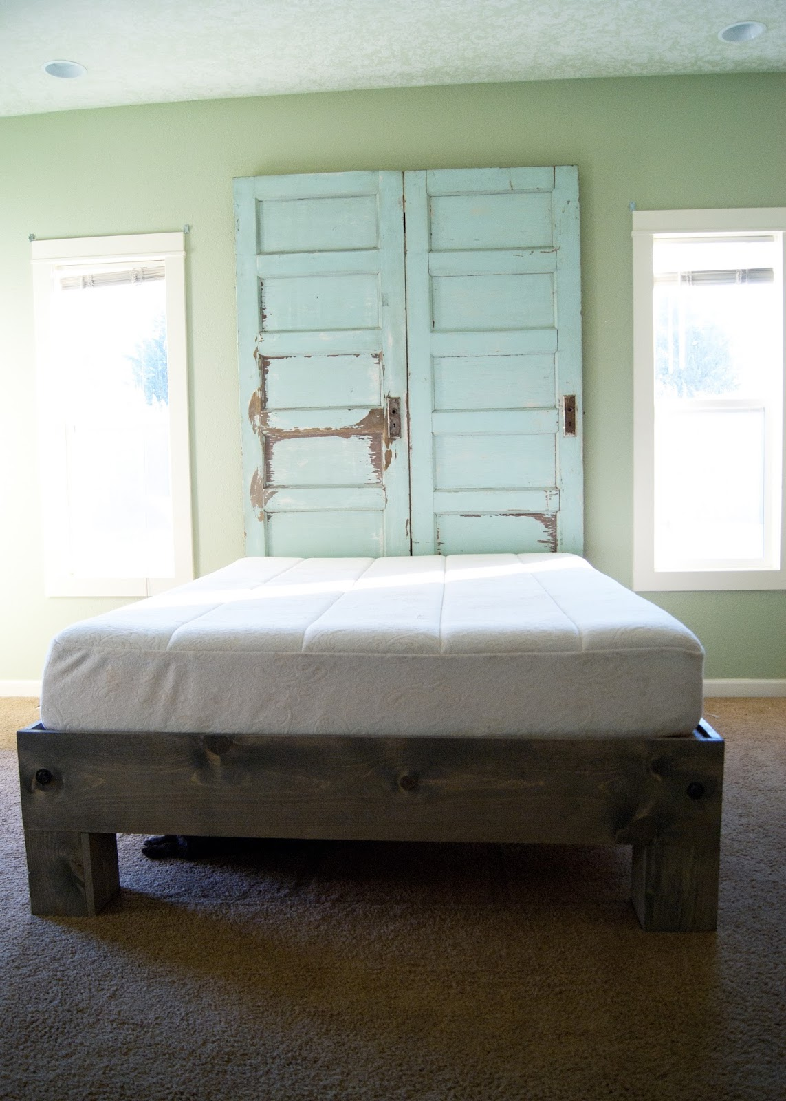 Platform bed and Old door headboard in mint green and weathered gray stain