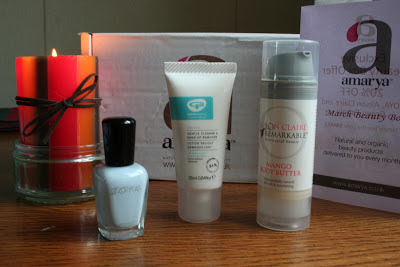 a picture of zoya nail polish in 'blu', alison claire mango body butter and green people gentle cleanse and make up remover
