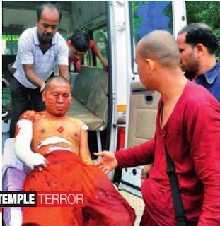 An injured Buddhist monk is taken for treatment to the Anugrah Narayan Magadh Medial College in Bodh Gaya, Bihar
