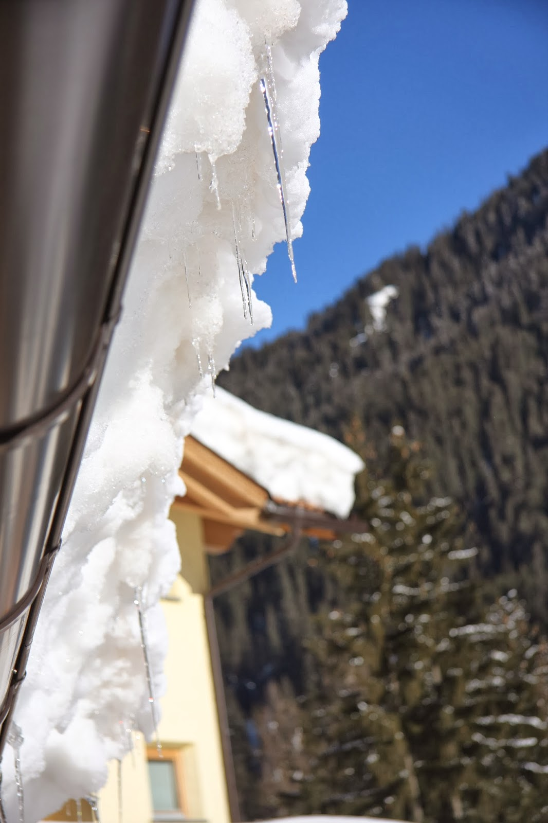 Icicles & Snow Hanging off the Roof