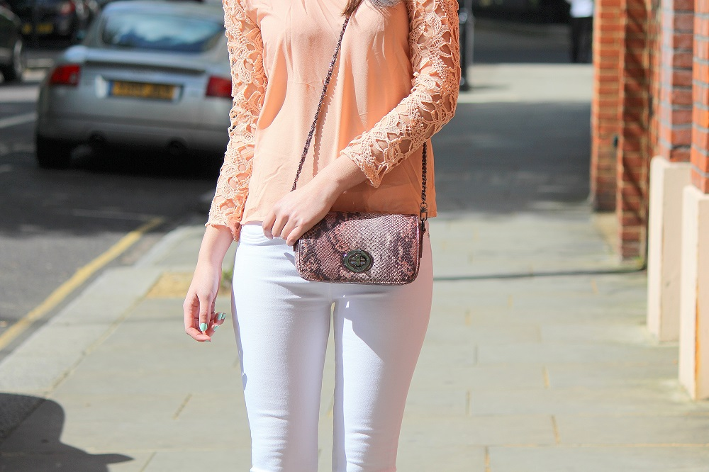 peexo fashion blogger wearing white jeans and lace top in spring