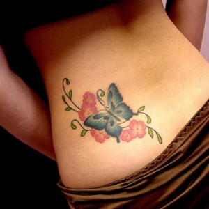 Lower back flower and butterfly tattoos