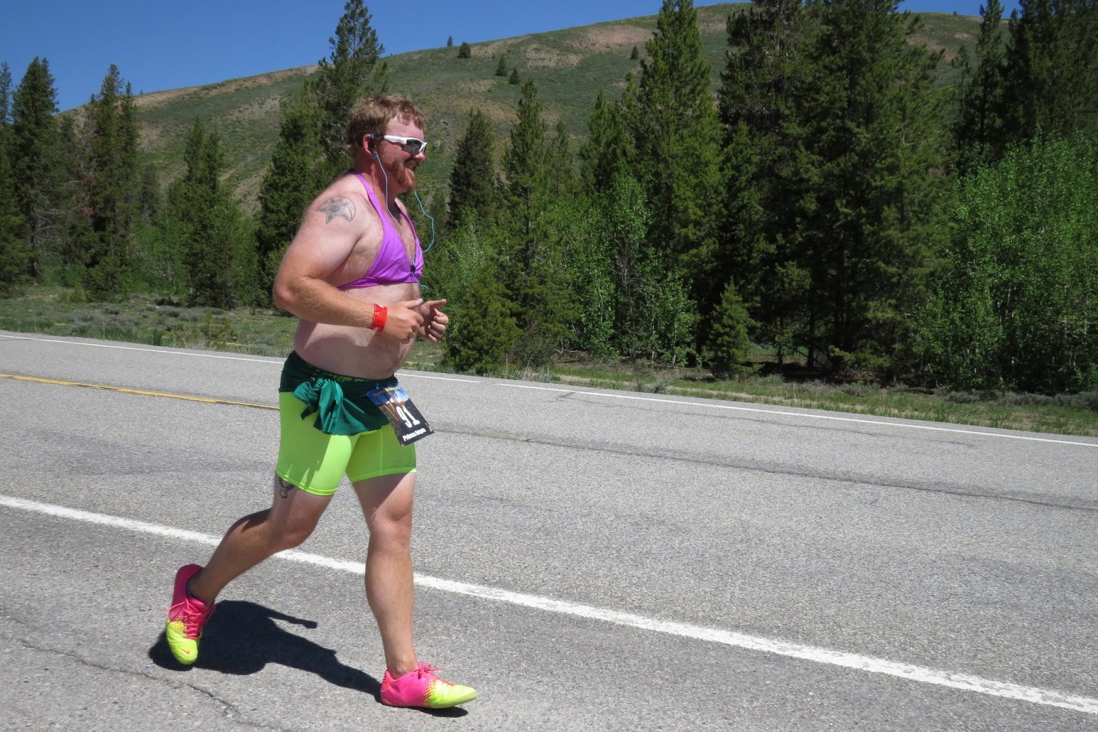 man running in a bikini