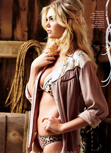 Kate Upton posing in a horse stable wearing lingerie