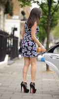 Kelly Brook getting into the car