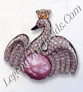 One of Verdura's swan brooches; this example is made of a baroque pearl with diamond coronet and wings.