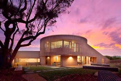 Fachada de casa de madera circular