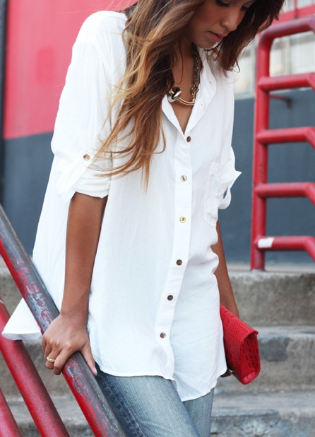 White shirt, red purse and jeans