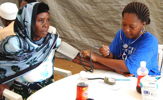 Hadija having her blood pressure checked at the Tigo - Rotary Free Medical Camp -