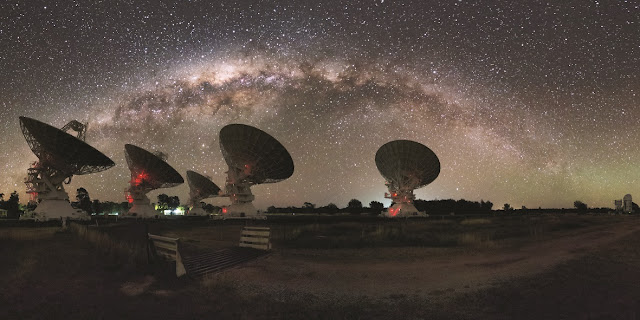 CSIRO's Compact Array in Australia under the night lights of the Milky Way. Credit: Alex Cherney