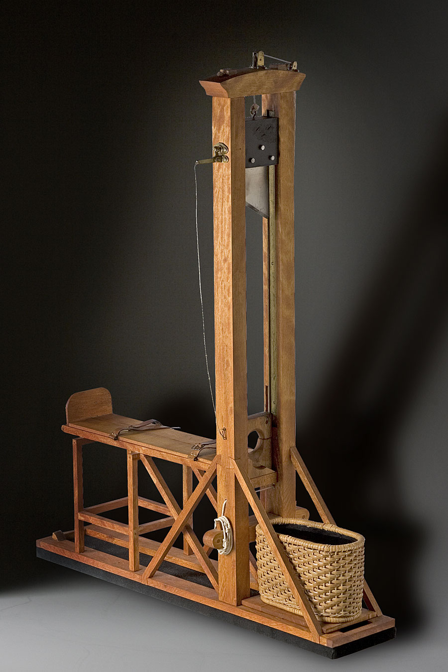 """the guillotine 1 its origins date back to the middle ages the name """"guillotine"""" dates to the 1790s and the french revolution, but similar execution machines had already been in existence for centuries."""