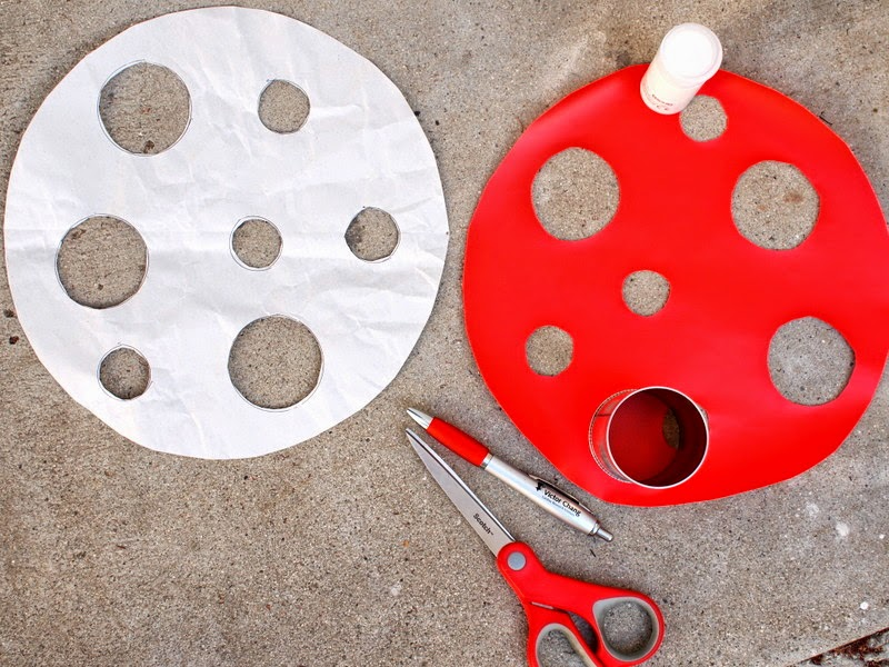 To make a DIY Ikea Hack toadstool seat, cut out a red contact paper top