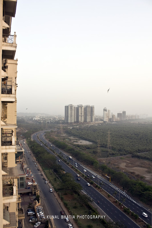 view of palm beach road from high rise skyscraper in sanpada, navi mumbai by mumbai photographer kunal bhatia