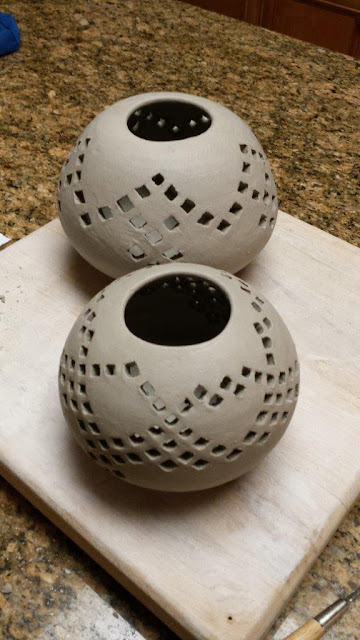 Pierced ceramic pottery spheres, in progress, inspired by Eric Stearns Pottery.