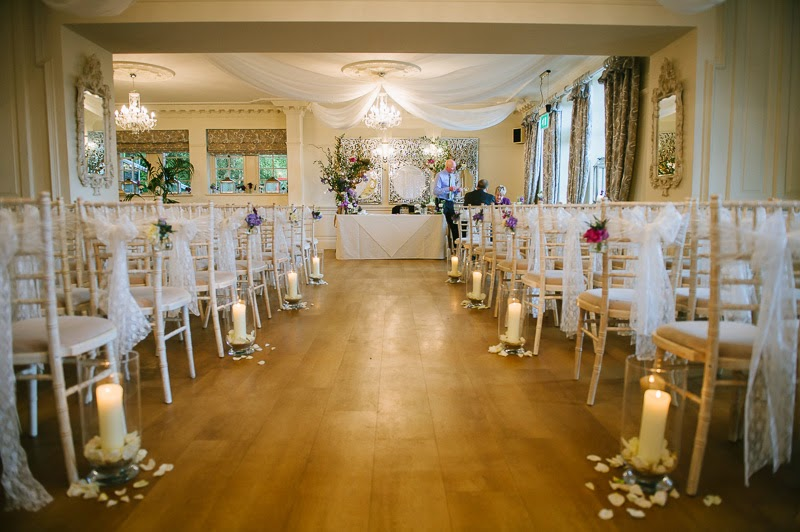 ... Two Of Our Enchanted Trees Framing The Registrars Table, Candlelit  Hurricane Lamps And Posies Of Fresh Flowers Hanging On The Chairs Lining  The Aisle