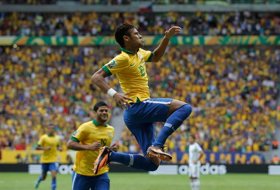 Brazil forward Neymar celebrates after scoring the opening goal against Japan