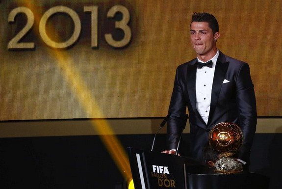 Cristiano Ronaldo reacts after being awarded the FIFA Ballon d'Or 2013