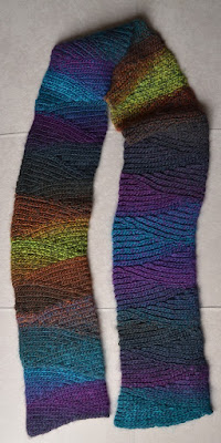 Shadow Spectrum slip stitch scarf graduates through purple, turquoise, browns and greens.