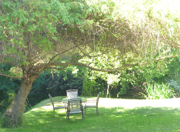 serene seating by the river in Gathers garden