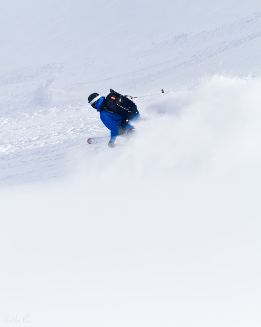Skier does a powder turn Stanley MItchell Hut.