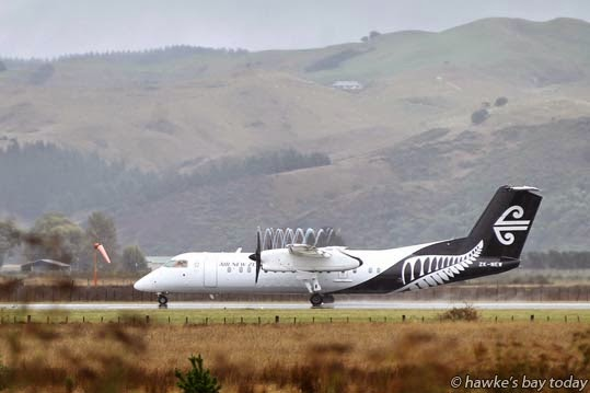 An Air New Zealand plane takes off in the misty rain at Hawke's Bay Airport, Napier.