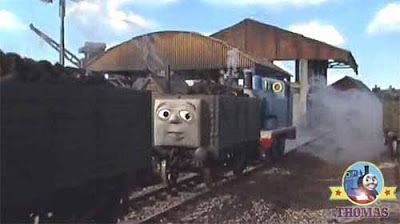 Thomas the blue train shunted the last rail truck wagon crossly thrusting it in place bang and bump