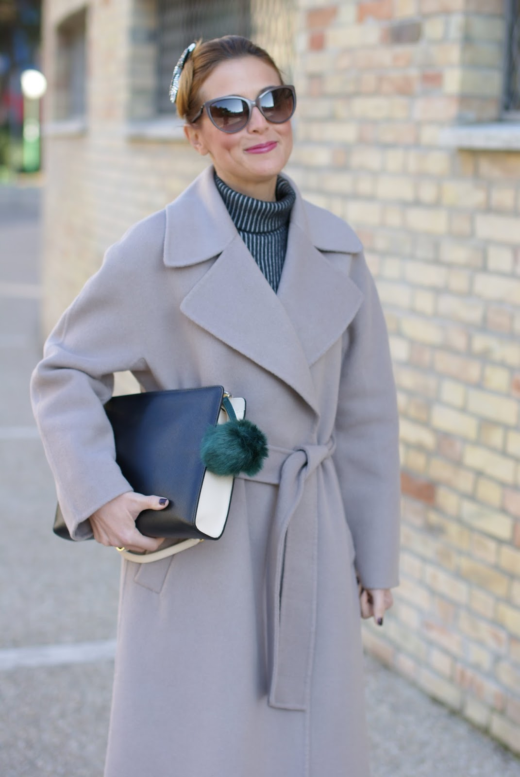 Chic and sophisticated look with a Vogos Mathilda coat, Prada inspired hairdo and Notes clutch on Fashion and Cookies fashion blog, fashion blogger style