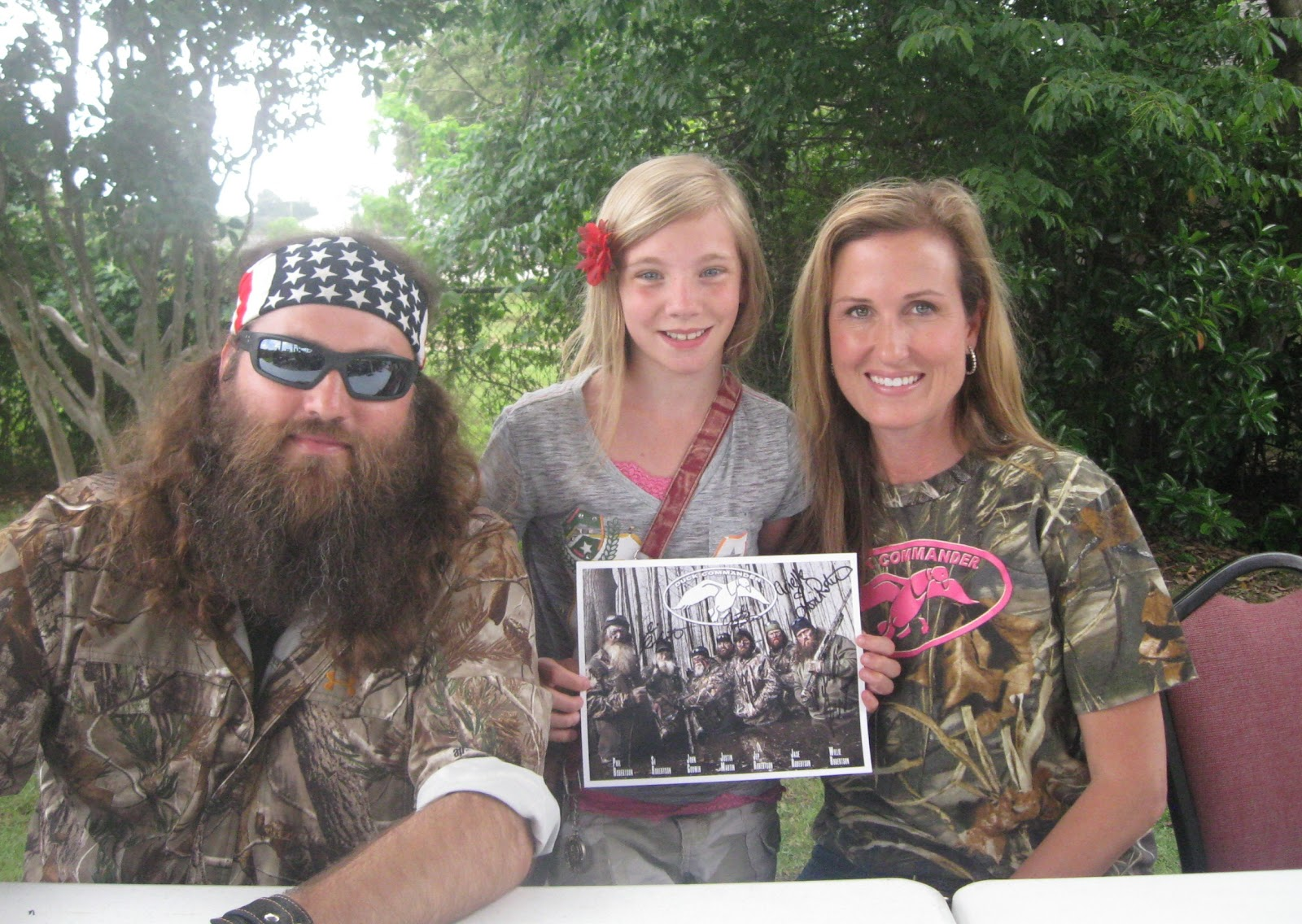 My daughter with Willie and Korie Robertson from Duck Dynasty.