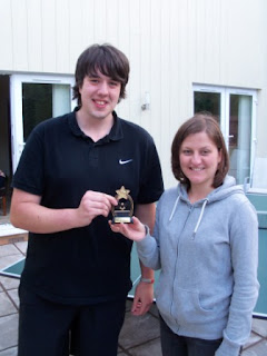Seve receives the Cwmbran Table Tennis Classic Tournament Trophy from Emily