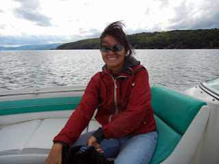 Me enjoying riding on a boat on one of the Finger Lakes in New York