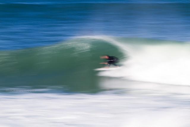 blur surfer surfing waves at bronte beach sydney australia