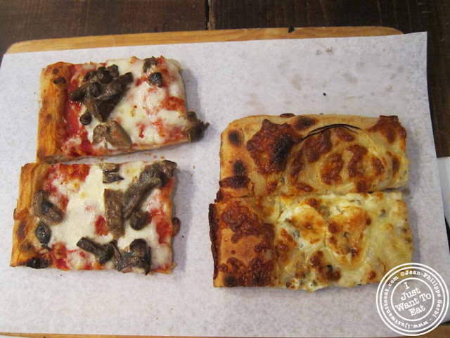 Image of mushroom pizza and the Cipola Y Gorgonzola (onions and gorgonzola) pizza at Pizza Roma in NYC, New York