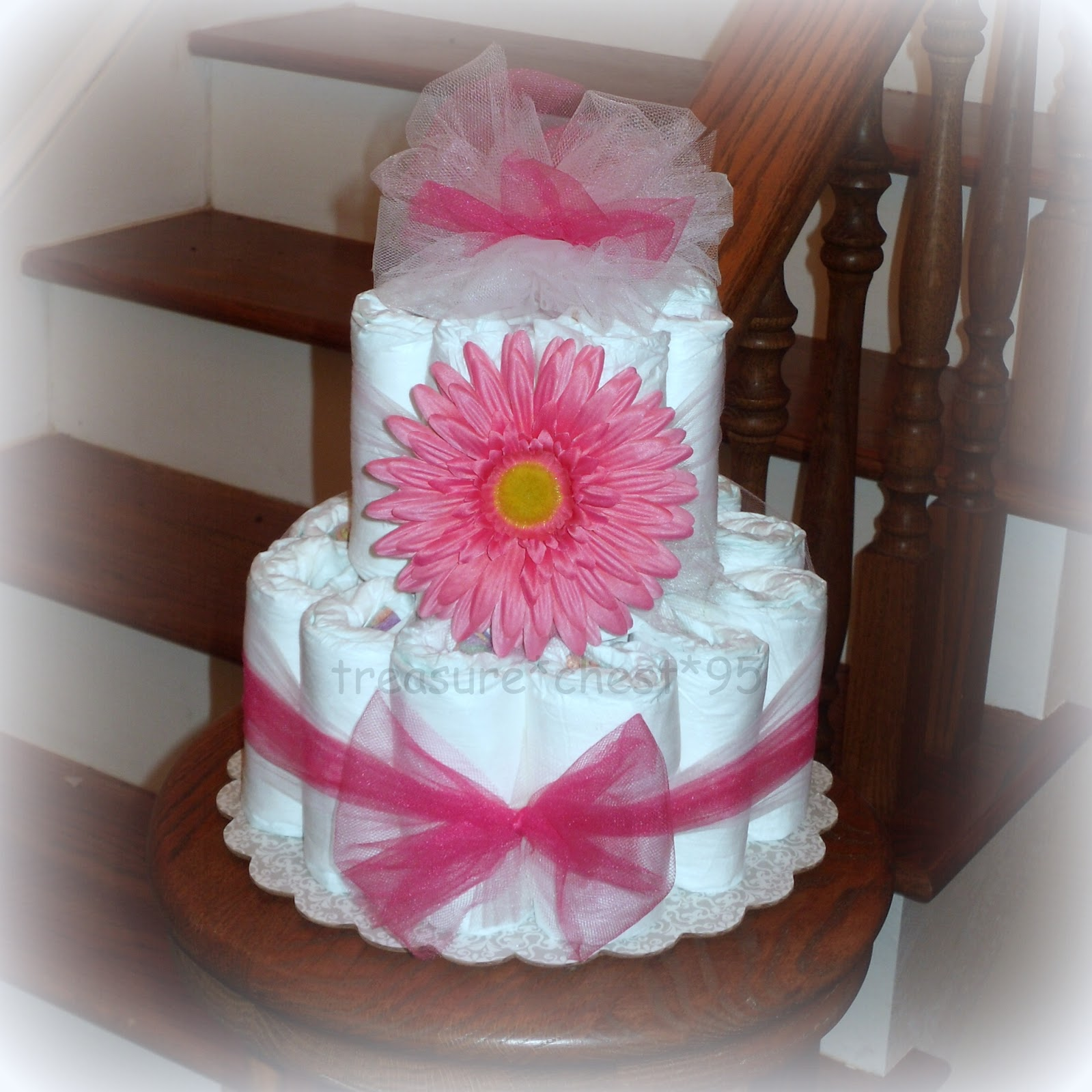 Gerber daisy diaper cake centerpiece baby shower gift for Baby shower diaper decoration